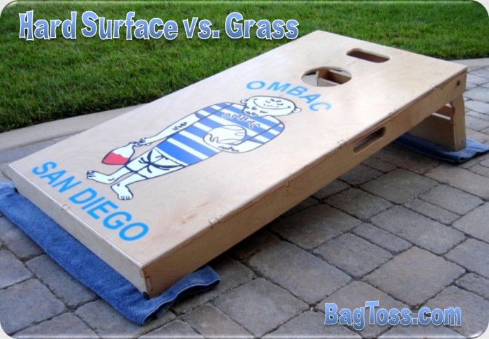 You can improve how the bag toss cornhole board plays on hard surfaces buy placing an old towel underneath the legs to make it respond more like grass